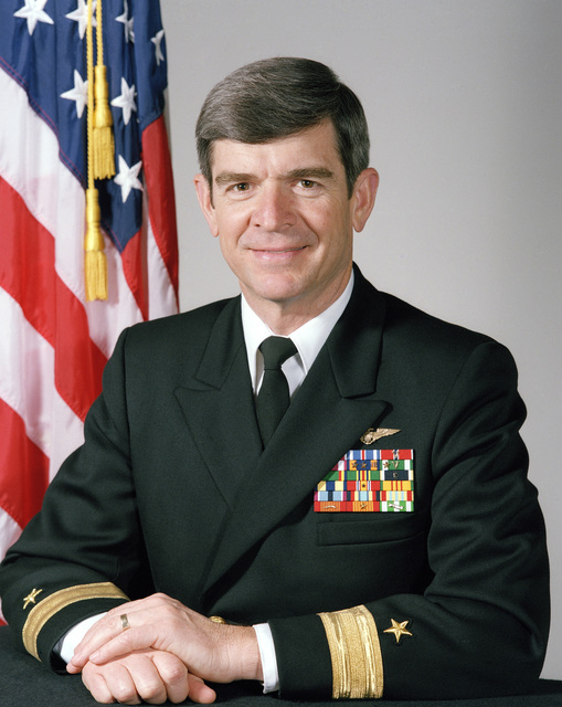 Rear Admiral (RDML) (lower half) Jerome L. Johnson, USN (uncovered)