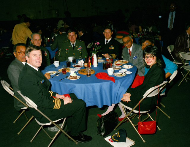 Captain Thomas A. Mercer, center right, commanding officer of the nuclear-powered aircraft carrier USS CARL VINSON (CVN 70), and representatives of the San Francisco Bay Area Combined Federal Campaign enjoy the CFC finale luncheon held aboard the ship