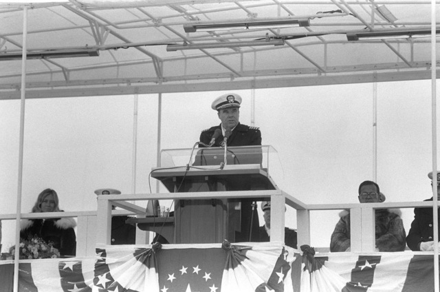 Captain Robert F. Fox, supervisor of Shipbuilding, Conversion and Repair, speaks during the commissioning of the nuclear-powered strategic missile submarine USS ALASKA (SSBN 732)