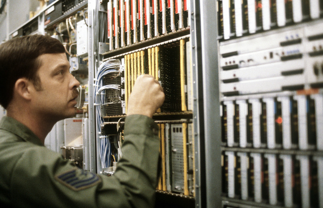 A member of the 2179th Information Systems Group inspects circuit boards