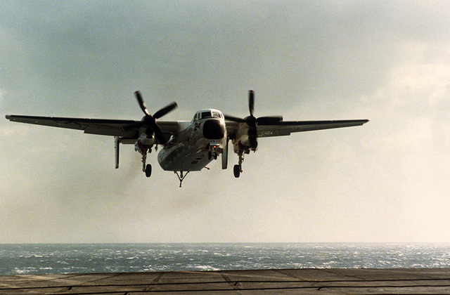A C-2A Greyhound aircraft approaches for a landing aboard the aircraft carrier USS SARATOGA (CV-60)