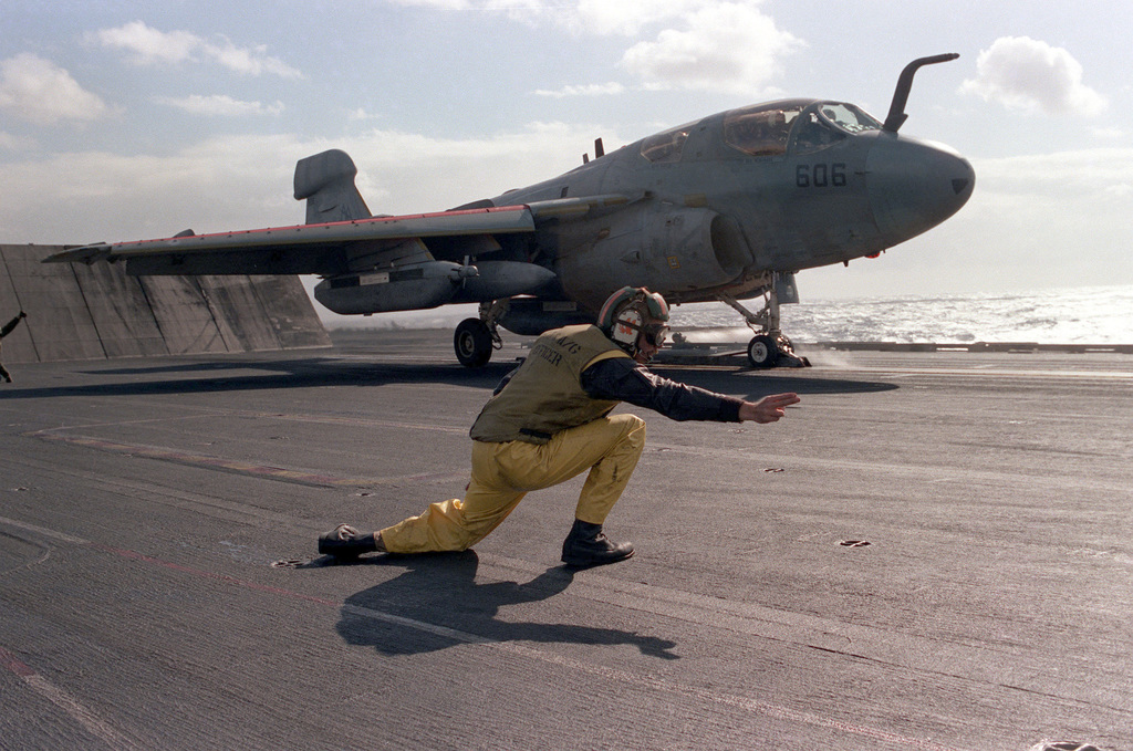 A catapult officer aboard the aircraft carrier USS SARATOGA (CV 60) signals with two fingers that an EA-6B Prowler aircraft is ready to be launched