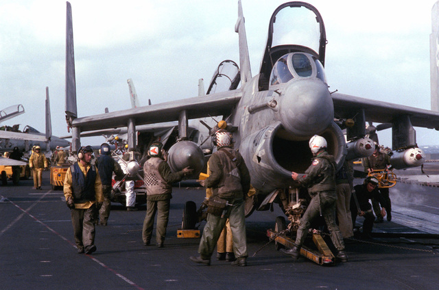 A pilot performs a preflight inspection of his A-7E II Corsair aircraft prior to flight operations aboard the aircraft carrier USS SARATOGA (CV 60)