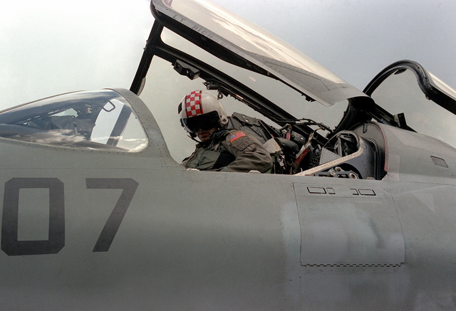 A pilot straps himself into the cockpit of his EA-6B Prowler aircraft at the start of flight operations aboard the aircraft carrier USS SARATOGA (CV-60)