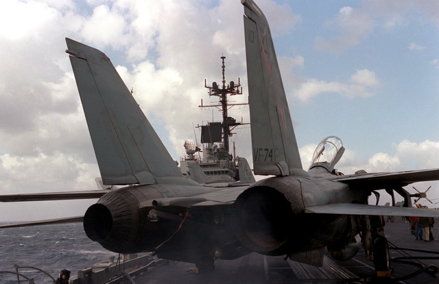 A rear view of an F-14A Tomcat aircraft from Fighter Squadron 74 during a preflight check aboard the aircraft carrier USS SARATOGA (CV 60)