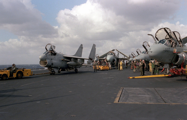 Among the aircraft being respotted on the flight deck of the aircraft carrier USS SARATOGA (CV 60) are an A-7E Corsair II, an A6E Intruder, F-14A Tomcatsand an EA-6B Prowler