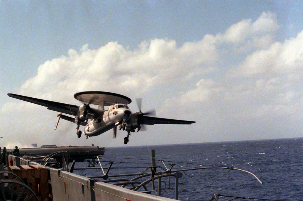 An E-2C Hawkeye aircraft is launched from the aircraft carrier USS SARATOGA (CV 60)