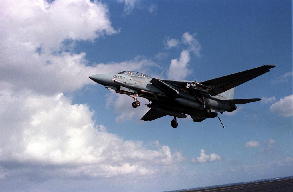 An F-14A Tomcat aircraft approaches for a landing aboard the aircraft carrier USS SARATOGA (CV 60)