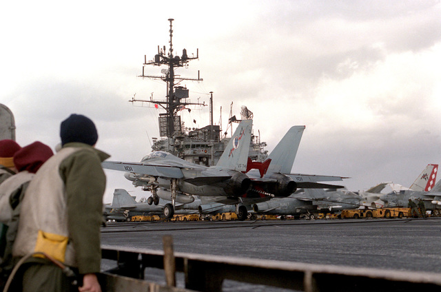 An F-14A Tomcat aircraft from Fighter Squadron 74 lands aboard the aircraft carrier USS SARATOGA (CV 60)
