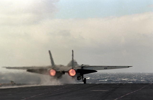 An F-14A Tomcat aircraft is launched from the aircraft carrier USS SARATOGA (CV 60)