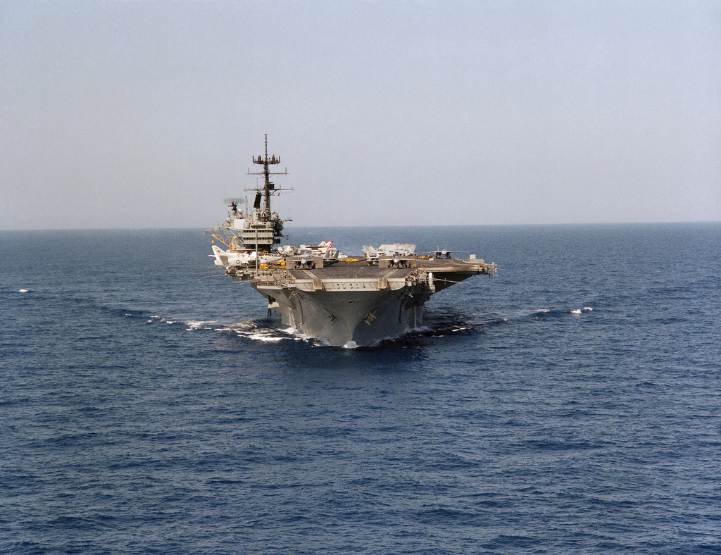 Bow view of the aircraft carrier USS SARATOGA (CV 60) underway. F-14 Tomcat aircraft are set for launch on three of the ship's catapults