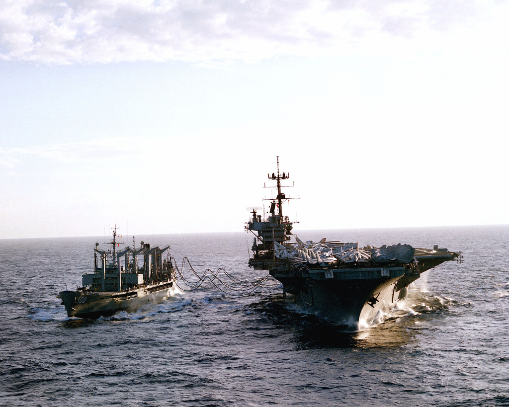 The aircraft carrier USS SARATOGA (CV 60) is refueled while underway by the auxiliary oiler USNS PAWCATUCK (T-AO 108). (Substandard image)