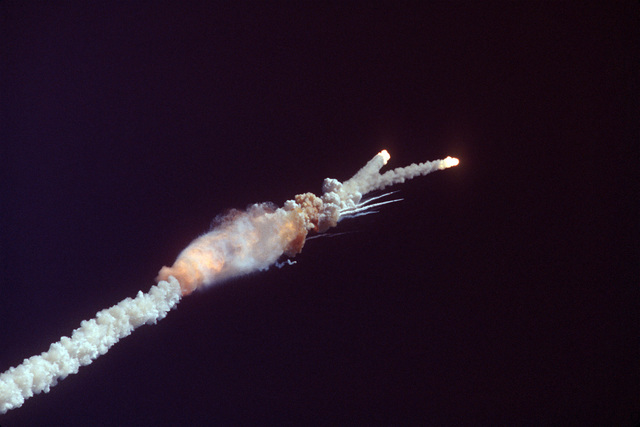 The space shuttle Challenger explodes 73 seconds after liftoff from the Kennedy Space Center. Note: Sixth view in a series of eight
