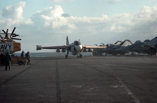 An A-6E Intruder aircraft lands during flight operations aboard the aircraft carrier USS CORAL SEA (CV 43)
