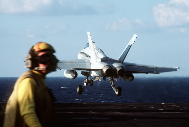 An F/A-18A Hornet aircraft is launched from the aircraft carrier USS CORAL SEA (CV-43)