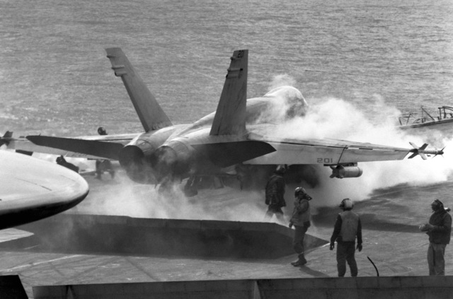 The jet blast deflector is raised behind an F/A-18A Hornet aircraft prior to launch from flight deck of the aircraft carrier USS CORAL SEA (CV 43)