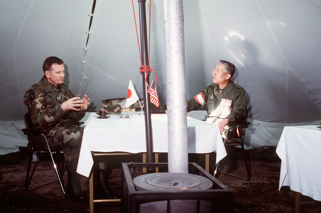 Lieutenant General (LGEN) Charles W. Dyke, commander, US Army Japan, speaks with LGEN Akira Igarashi, commander of Japan's Northern Army during Exercise YAMA SAKURA IX at Camp Chitose