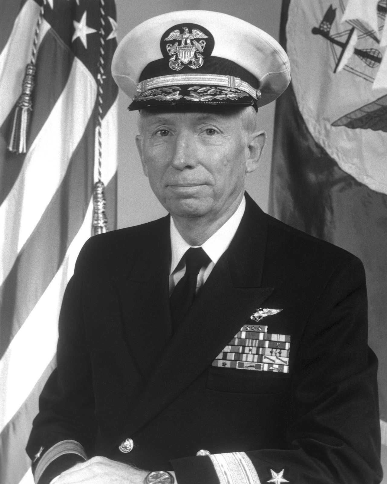 Rear Admiral (lower half) James E. Taylor, USN (covered)