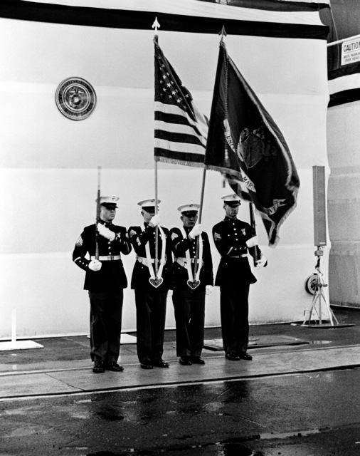 A Marine Corps color guard from the 4th Landing Support Battalion, Naval Base, Seattle, parades the colors during the launching of the dock landing ship USS FORT MCHENRY (LSD 43) at the Lockheed shipyard