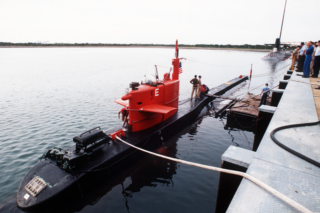 A port bow view of the nuclear-powered research submersible NR-1 moored to a pier