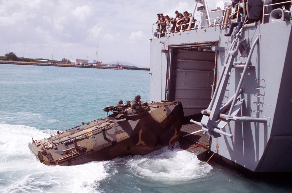 An LVTP7 personnel tracked landing vehicle enters the docking well of a tank landing ship