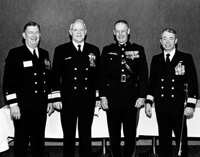 Attending the launching of the USS Fort McHenry (LSD 43) are (left to right): Rear Admiral (RDML) John J. Higginson, commanding officer, Amphibious Group Three; Rear Admiral (RADM) L. Severance, commander, Naval Base, Seattle; Major General (MGEN) Anothy Lukeman, commanding general, Marine Corps Recruit Depot, San Diego; and Rear Admiral (RDML) Harry K. Fiske, Naval Sea Systems Command