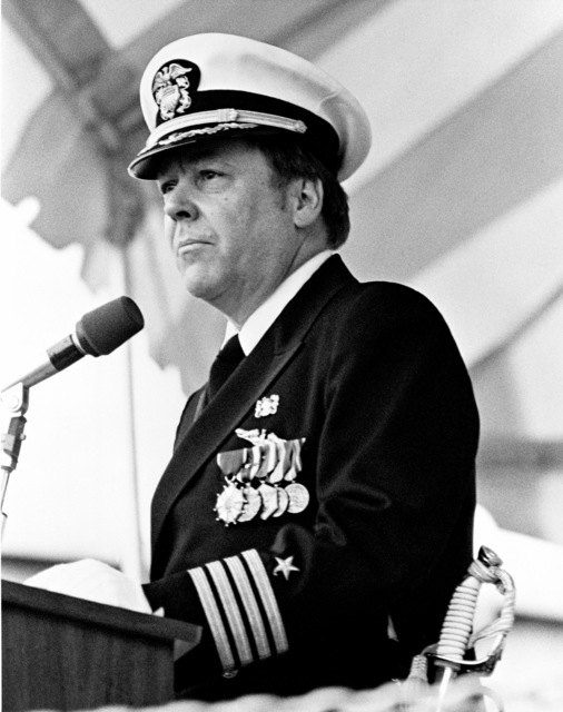 Captain James J. Coleman, command representative, Naval Sea Systems Command, speaks during the launching of the dock landing ship USS FORT MCHENRY (LSD 43) at the Lockheed shipyard