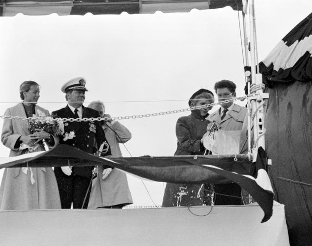 The dock landing ship USS FORT MCHENRY (LSD 43) is christened by Representative Helen D. Bentley, D-Maryland, at the Lockheed shipyard. Standing on the platform are (left to right): Margaret Davis, matron of honor; Captain (CAPT) James J. Coleman, command representative, Naval Sea Systems Command; and Thomas J. McGrath, director, dock landing ship program, Lockheed shipyard.