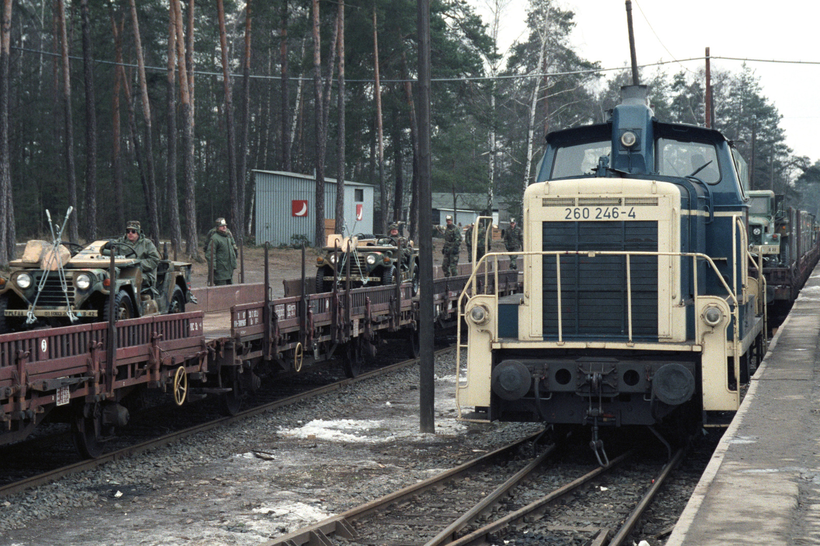 A locomotive prepares to haul a train loaded with ground