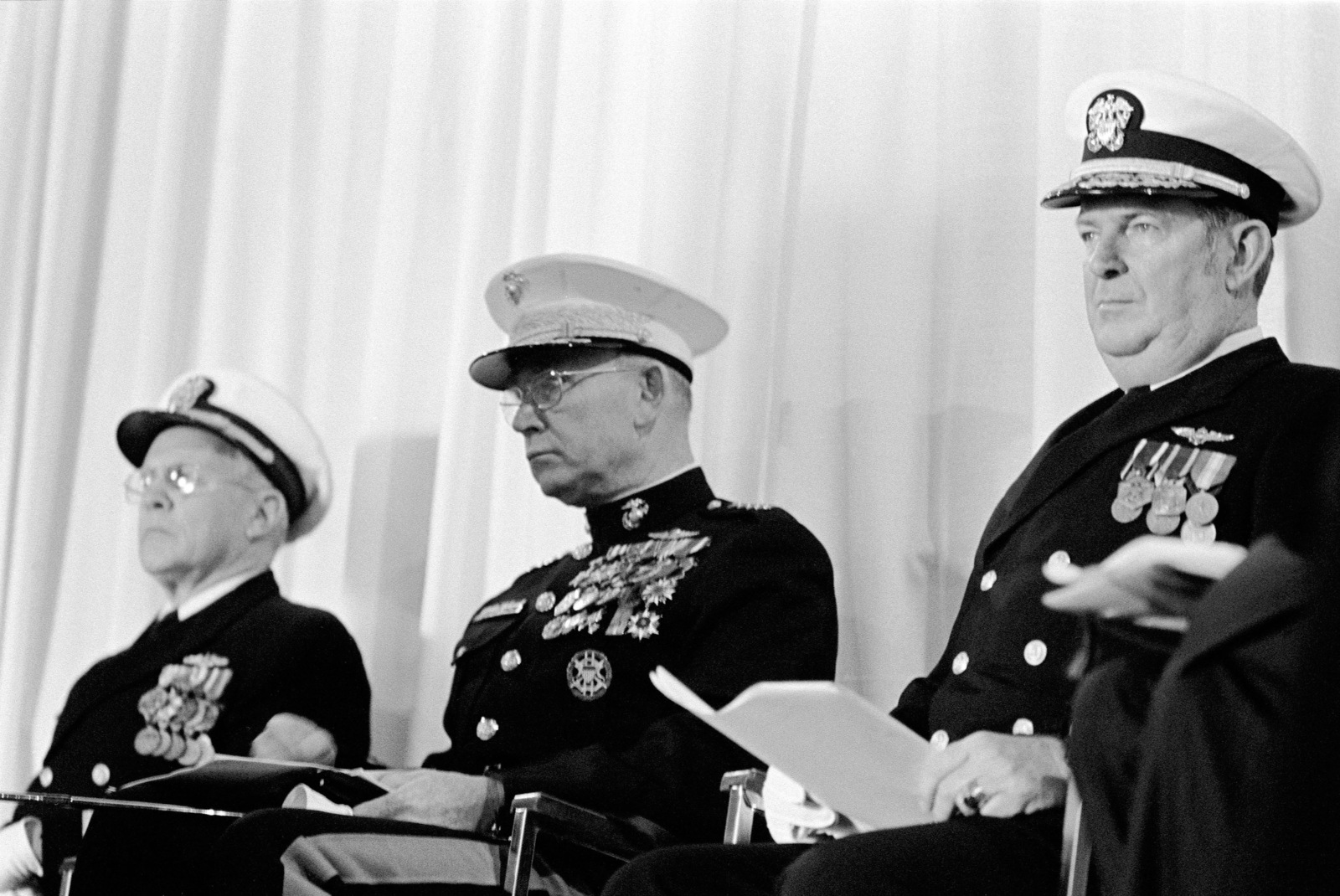 Attending the commissioning of the dock landing ship USS GERMANTOWN (LSD 42) at the Lockheed shipyard are (left to right): Rear Admiral Laverne S. Severance Jr., commander, Naval Base, Seattle; General (GEN) Paul X. Kelley, commandant of the Marine Corps; and Rear Admiral (RDML) (lower half) John J. Higginson, commander, Amphibious Group Three