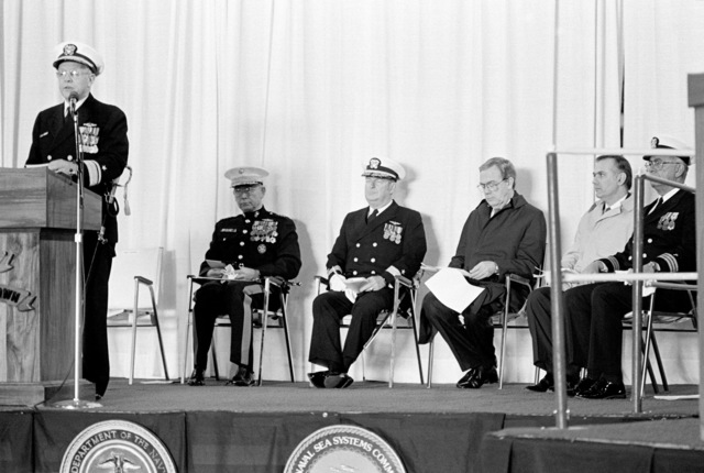 Rear Admiral Laverne S. Severance Jr., commander, Naval Base, Seattle, speaks during the commissioning of the dock landing ship USS GERMANTOWN (LSD 42) at the Lockheed shipyard. Sitting in the background are (left to right): General (GEN) Paul X. Kelley, commandant of the Marine Corps; Rear Admiral (RDML) John J. Higginson, commander, Amphibious Group Three, and other distinguished guests