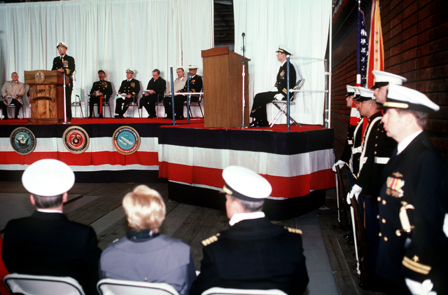 Rear Admiral (RADM) (upper half) (Laverne S. Severance, commanding officer, Naval Base, Seattle, speaks during the commissioning of the dock landing ship USS GERMANTOWN (LSD 42) at the Lockheed shipyard