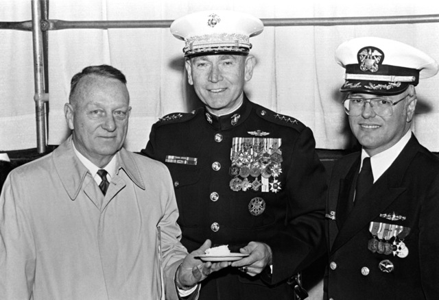 Retired COL. Eugene E. Shoults, projecdt manager, Amphibious Ship Acquisition Program, Naval Sea Systems Command; GEN. Paul X. Kelley, commandant of the Marine Corps; and CMDR. Edward M. Kline, commanding officer, attend a reception for the commissioning of the dock landing ship USS GERMANTOWN (LSD-42)
