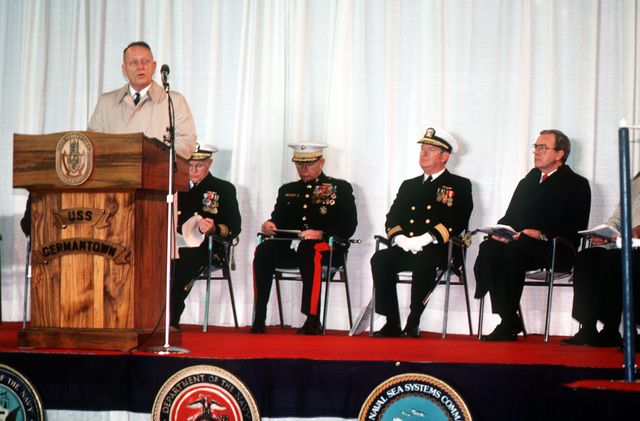 Retired Colonel (COL) Eugene E. Shoults, amphibious ship acquistion project manager, Naval Sea Systems Command, speaks during the commissioning of the dock landing ship USS GERMANTOWN (LSD 42) at the Lockheed shipyard