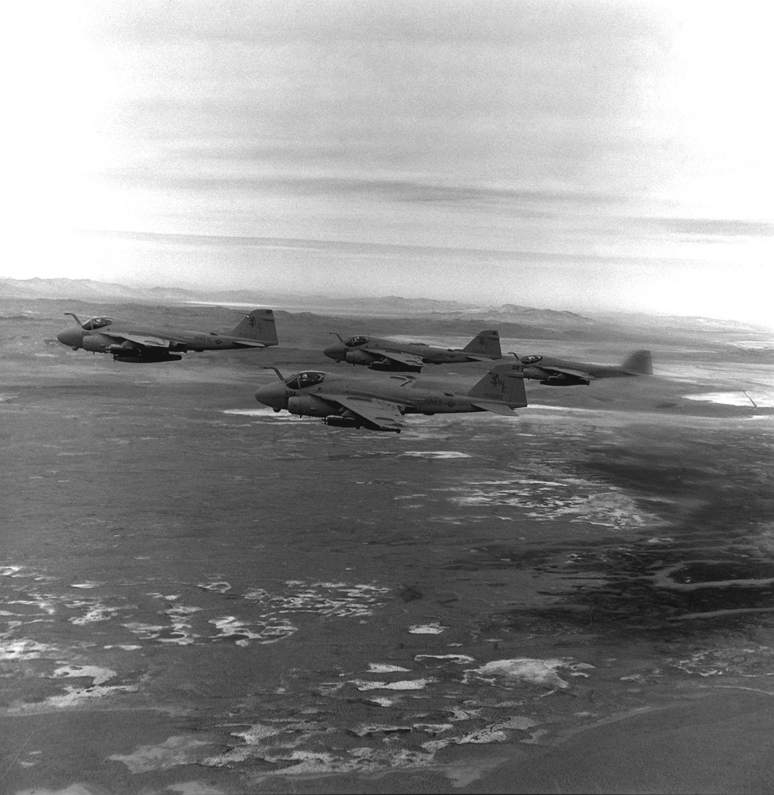 Loaded with Mark 82 500-pound bombs, four A-6E Intruder aircraft of Attack Squadron 145 (VA-145) fly to their target during a strike training mission