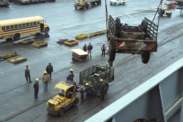A utility trailer is hoisted over the side of the vehicle cargo/rapid response ship USNS ANTARES (T-AKR 294) during offloading operations at the Dundalk Marine Terminal. The trailer was used by the 32nd Separate Infantry Brigade (Mechanized), Wisconsin Army National Guard, during Exercise REFORGER '86