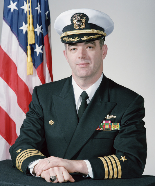 Captain (CAPT) Darrell W. Campbell, USN (covered)