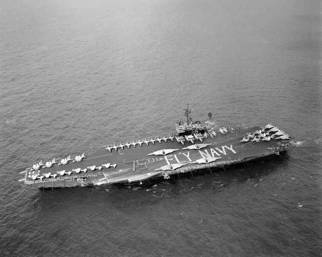 """Crewmen and members of Carrier Air Wing One form a """"75th Fly Navy"""" diamond anniversary salute to US naval aviation on the flight deck of the aircraft carrier USS AMERICA (CV 66). The ship is participating in Fleet Exercise 1-86"""