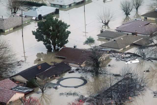 Flood water from a broken levee on the Yuba River swamps homes near the communities of Linda and Olivehurst. Waters from the break drove more than 24,000 residents from their homes. More than 5,000 residents are being left temporarily housed and fed by military personnel at nearby Beale Air Force Base