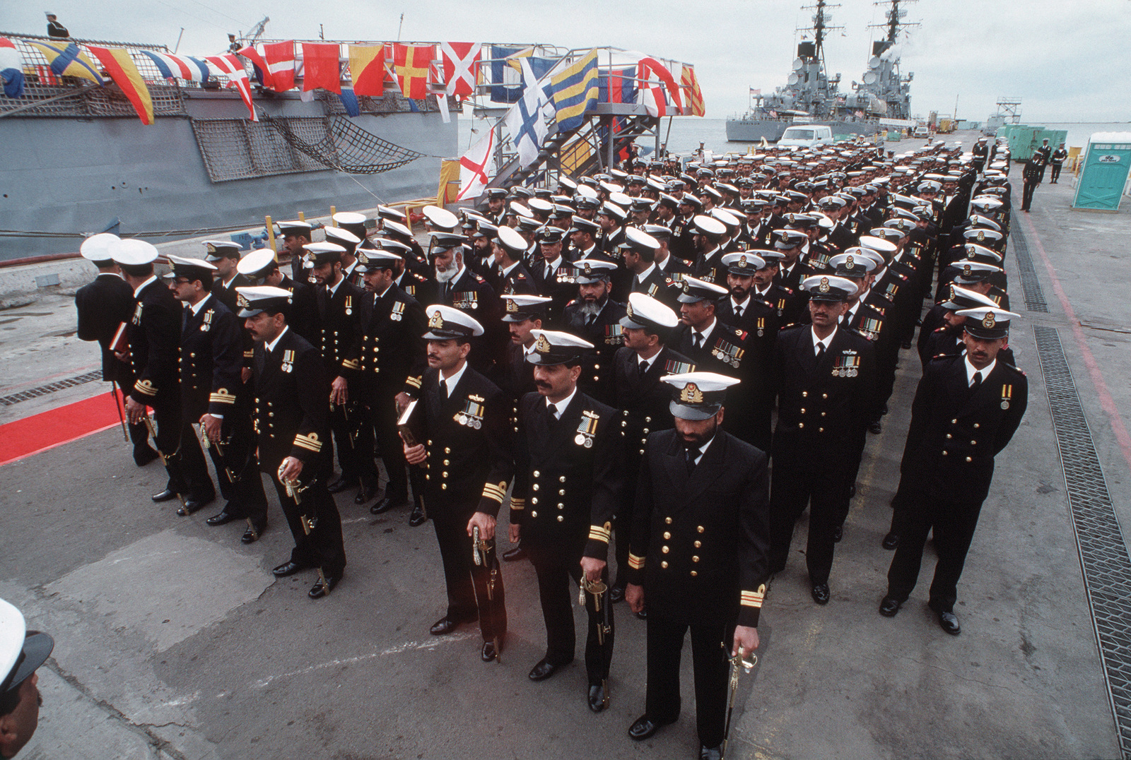 Pakistani officers and crewmen stand in formation during the commissioning ceremony of the former Guided Missile Frigate USS BROOKE (FFG 1) and the former frigate USS O'CALLAHAN (FF 1051) are transferred to the Pakistani navy.  The BROOKE is being commissioned PNS KHAIBAR (D 163) while the O'CALLAHAN becomes PNS ASLAT (F 265)