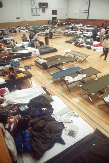 Residents of the communities of Linda and Olivehurst are sheltered on base at the Lindhurst High School gymnasium after being left temporarily homeless by flood waters from a broken levee on the Yuba River
