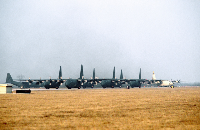 C-130E Hercules aircraft of the 37th Tactical Airlift Squadron taxi on the flight line during exercise Bluetail maneuvers, designed to test the operational readiness of the 435th Tactical Airlift Wing and wing tenant organizations