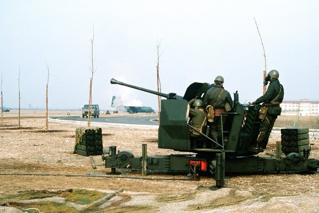 Members of Italy's 21st Artillery Group, Anti-aircraft Battery, man a 40mm L/70 anti-aircraft gun while participating in exercise Bluetail maneuvers, designed to test the operational readiness of the 435th Tactical Airlift Wing and wing tenant organizations