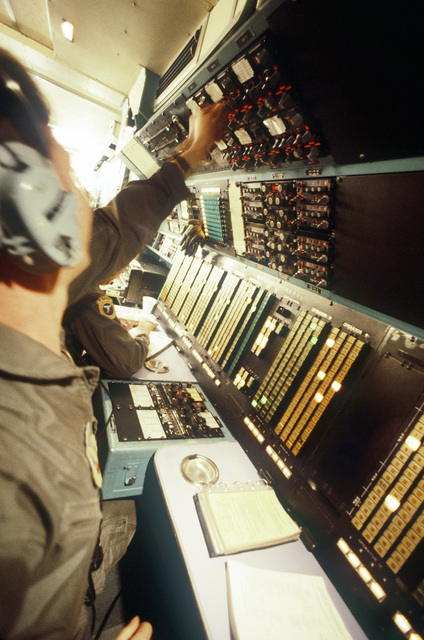 A member of the 7th Airborne Command and Control Squadron operates a console in an EC-130E Hercules airborne battlefield command and control center aircraft during exercise Team Spirit '86