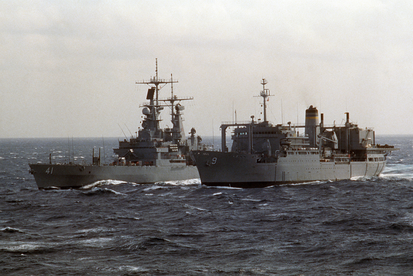 A port bow view of the combat stores ship USNS SPICA (T-AFS 9), right, and the nuclear-powered guided missile cruiser USS ARKANSAS (CGN 41) during an underway replenishment operation
