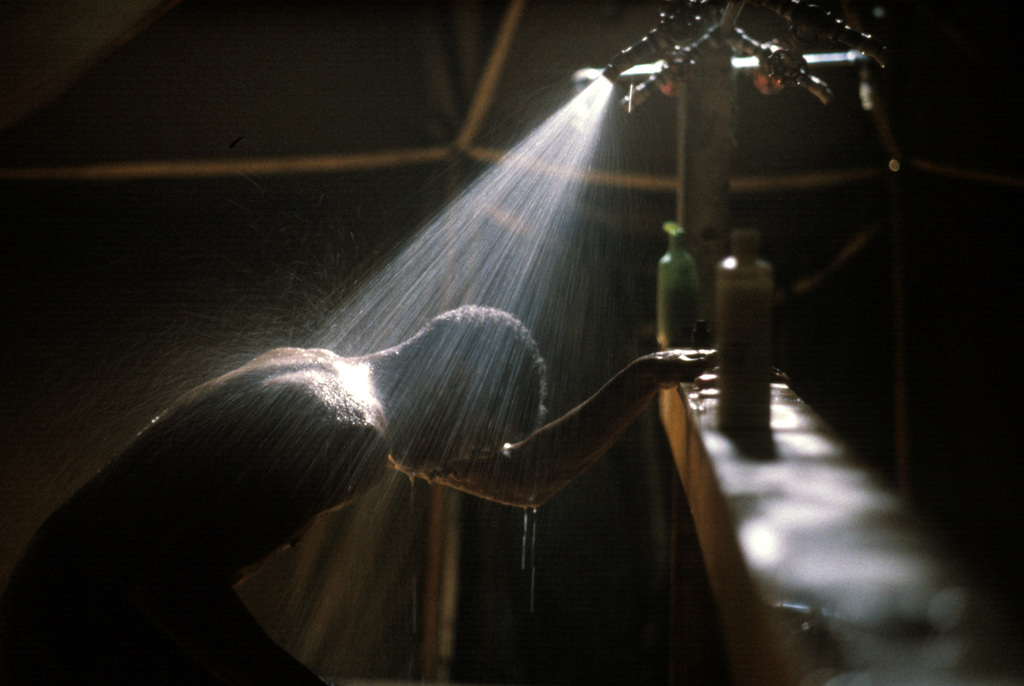 A US Air Force AIRMAN uses the tent shower facilities during Exercise TEAM SPIRIT '86