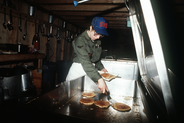 AIRMAN 1ST Class Yvonne L. Rickman, a food services specialist with the 305th Combat Support Group, prepares pancakes during exercise Team Spirit '86