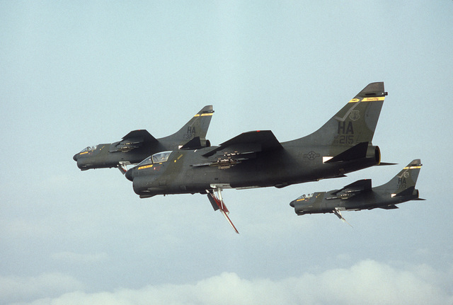 An air-to-air left side view of three 185th Tactical Fighter Group A-7D Corsair II aircraft in formation during Exercise TEAM SPIRIT'86