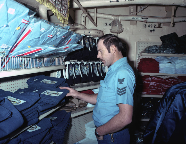 Boartswain's Mate 1ST Class Joe Laymon shops in the ship's store aboard the aircraft carrier USS SARATOGA (CV 60) during operations off the coast of Libya