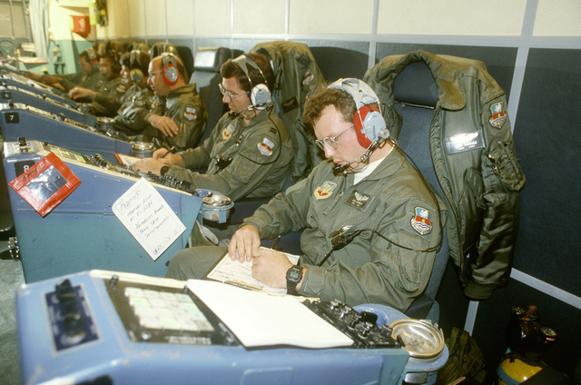 Members of the 7th Airborne Command and Control Squadron man their stations in an EC-130E Hercules airborne battlefield command control center aircraft during exercise Team Spirit '86
